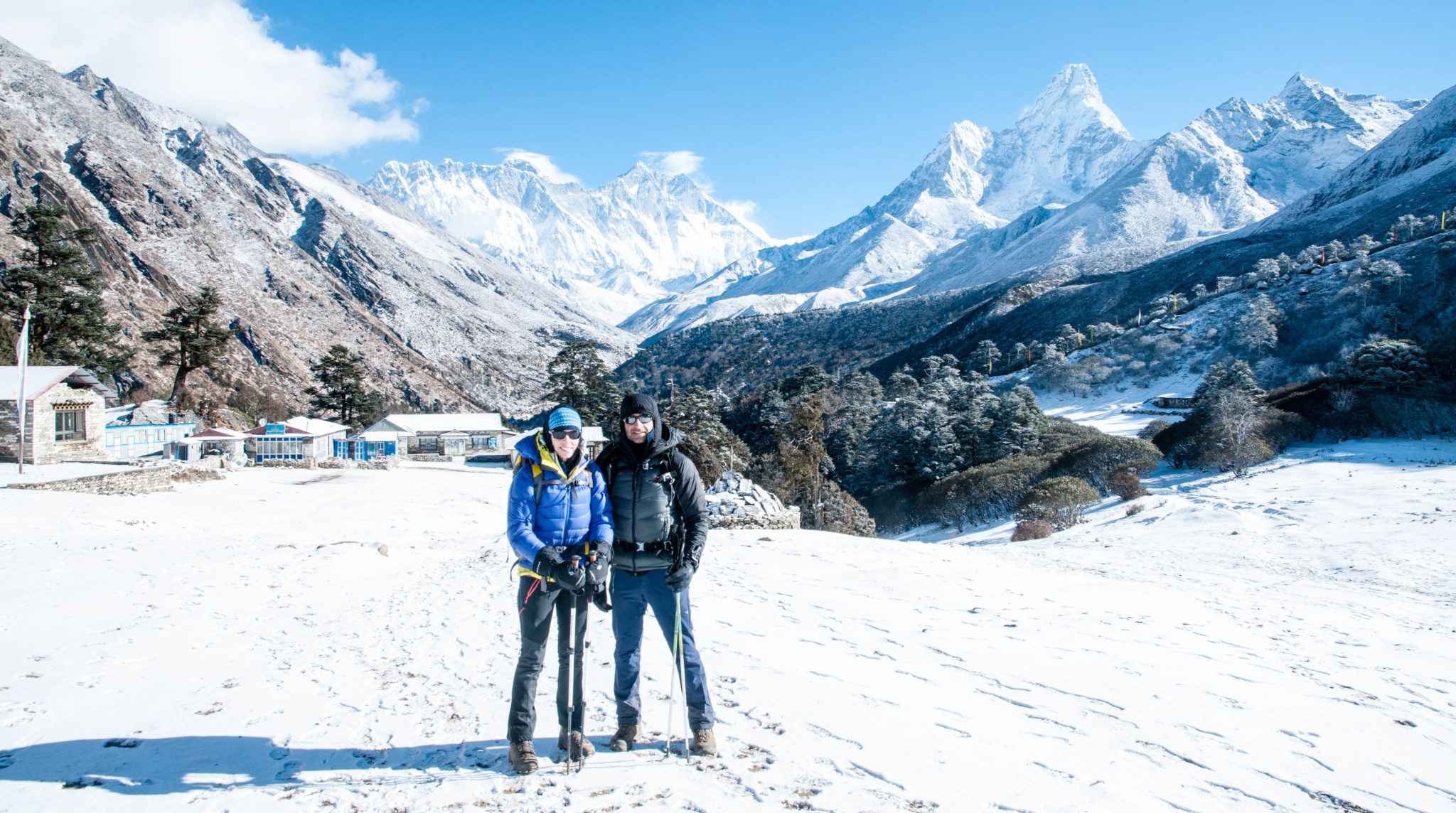 Julie and Shawn leaving Tengboche for Pangboche in the morning. Mount Everest's peak is just visible behind the background mountains.