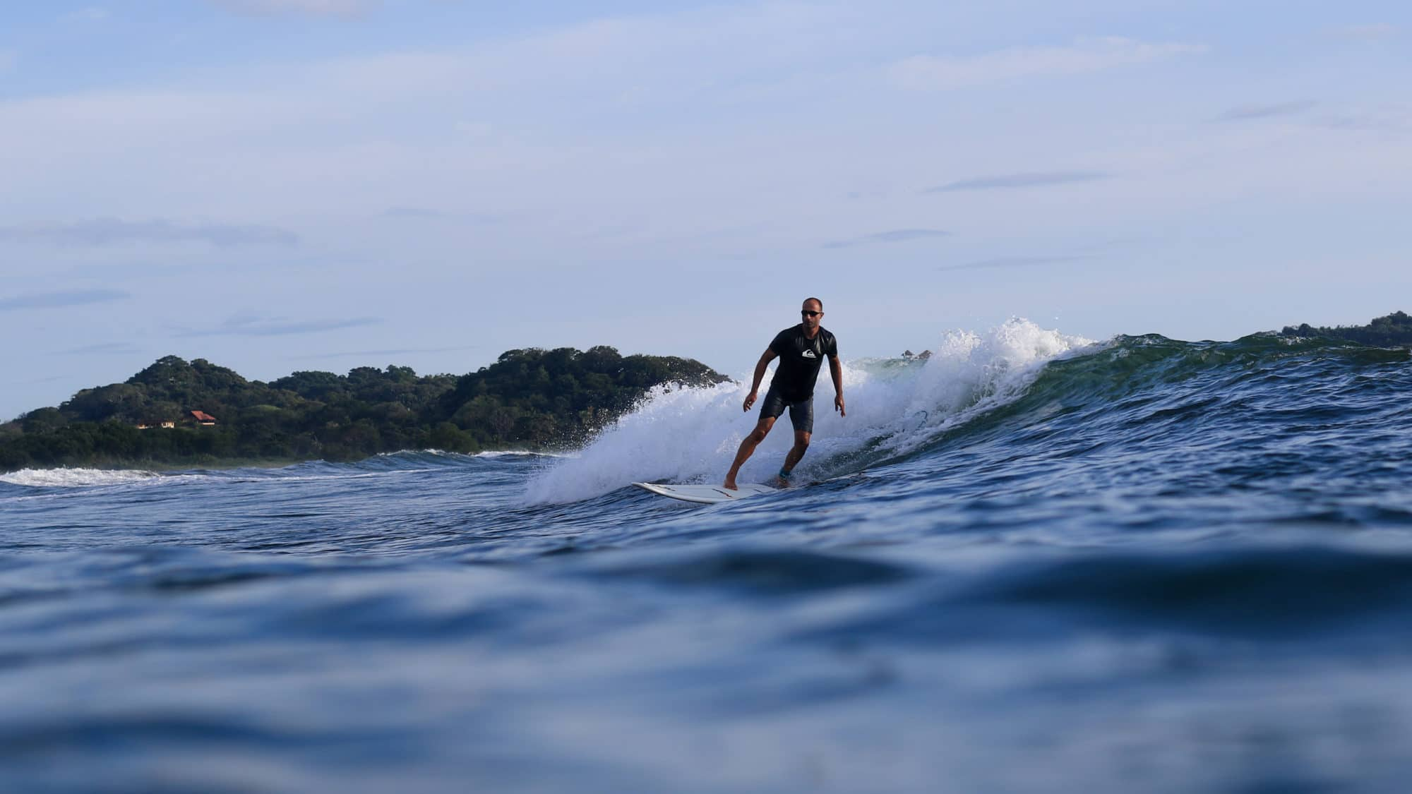 Shawn enjoying a sunset surf session in Costa Rica
